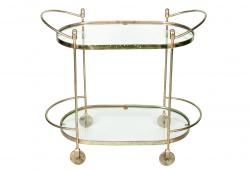 Mid Century Oval Two Tiered Solid Brass Bar Cart .