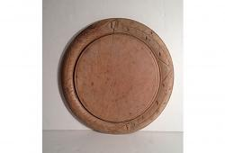 Round French bread board with carved flowers leaf design