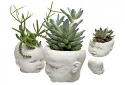 Set Of Four Cast Concrete Doll Head Planters