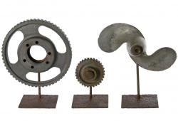 Set Of Three Metal Industrial Objects On Iron Stands